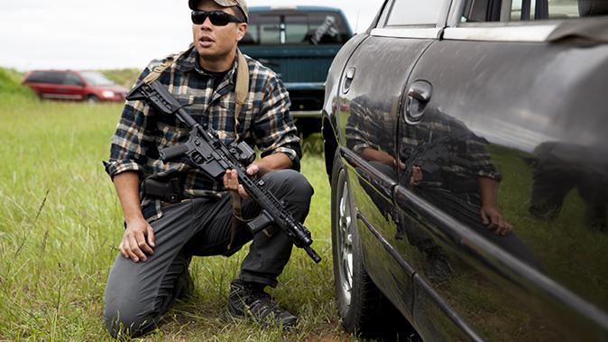 aaron barruga police shootout car crouching