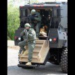 mrap vehicle police exiting