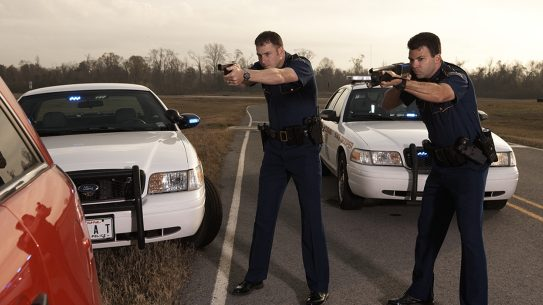 first responder driving guns drawn