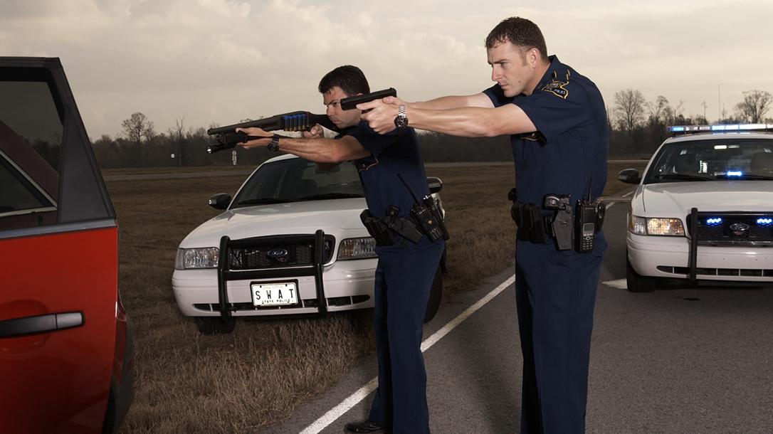 first responder driving shotgun pistol draw