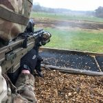 british army SA80A3 rifle shooting downrange