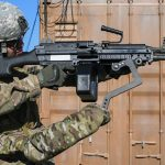 army third arm device m249 light machine gun