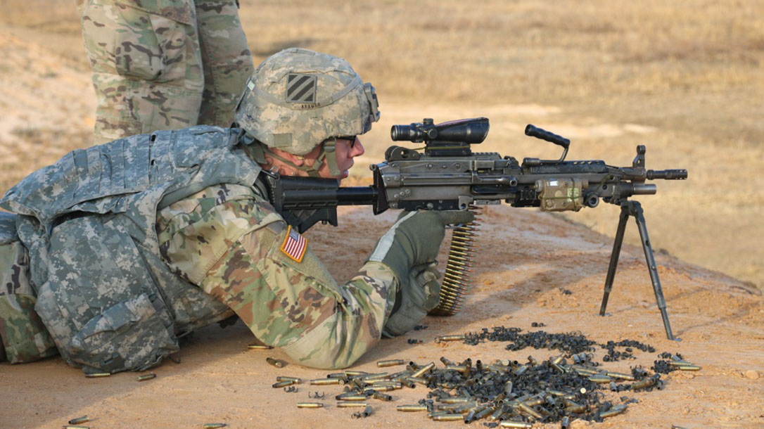 army m249 saw squad automatic rifle firing