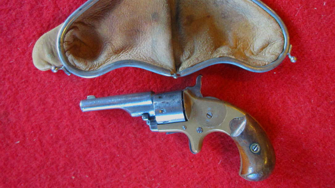 Woman's smart leather purses held old west guns such as this Colt Open Top Pocket Model