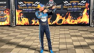 Henry presented Kevin Harvick with a rifle for winning the pole in Texas.