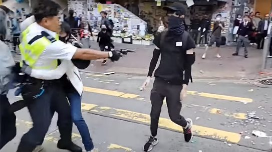Hong Kong Police shot an unarmed protestor.