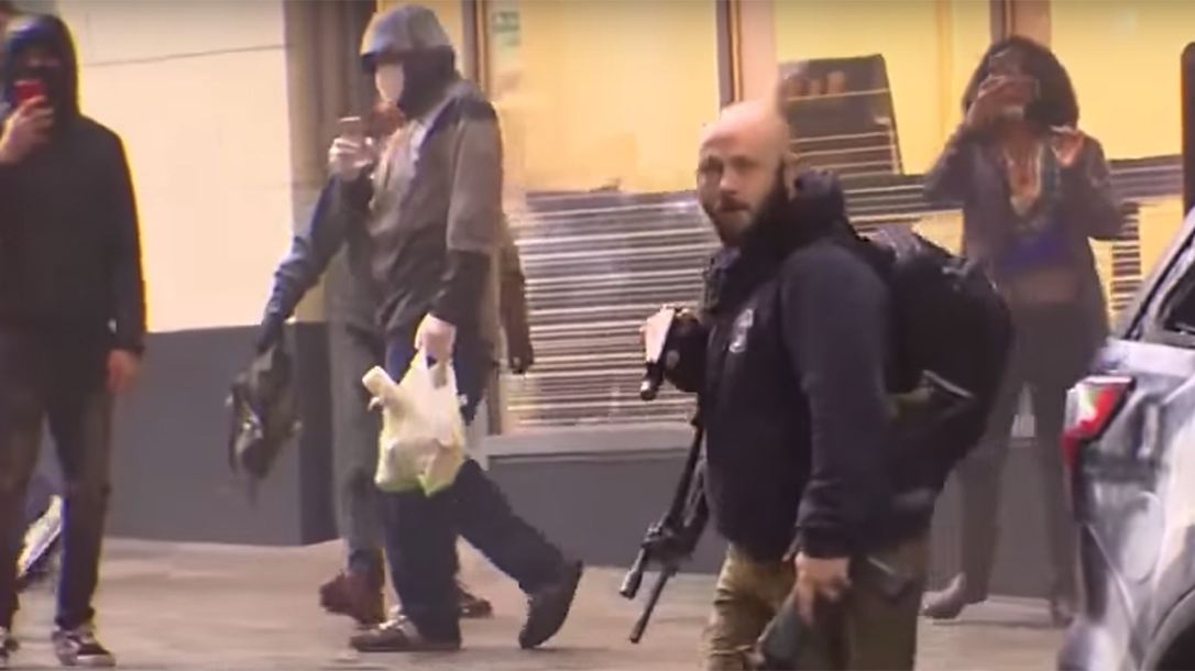 Security Guard disarms protestor rioter Seattle