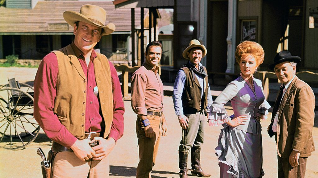 "Cast members of Gunsmoke including (left to right) James Arness as Marshal Matt Dillon, Burt Reynolds as Quint Asper, Ken Curtis as Deputy Festus Haggen, Amanda Blake as Kitty Russell and Milburn Stone as Galen ""Doc"" Adams."