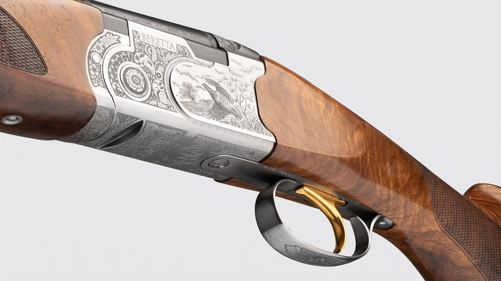 Fine laser engraving game scenes and scroll work highlight the 687 Silver Pigeon III.