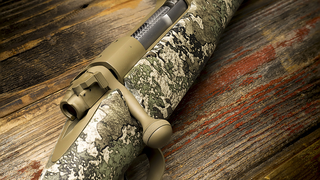 The exclusive Winchester Model 70 features an FDE Cerakote finish.