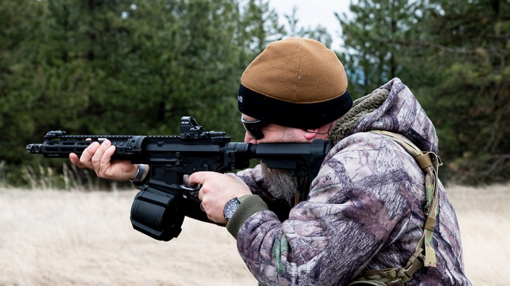 The author with the Cry Havoc Tactical AR pistol build and a Magpul PMAG D-60 drum.