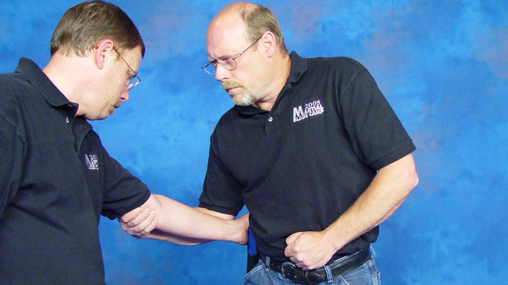 Fixed blades are obviously simpler to employ for edged weapon retention.