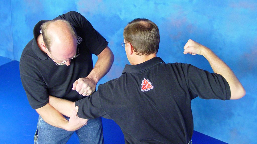 Then access your knife from the offside to target bicep and other vital biomechanical areas.
